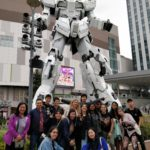 Ideal students in front of Gundam in Japan 2018