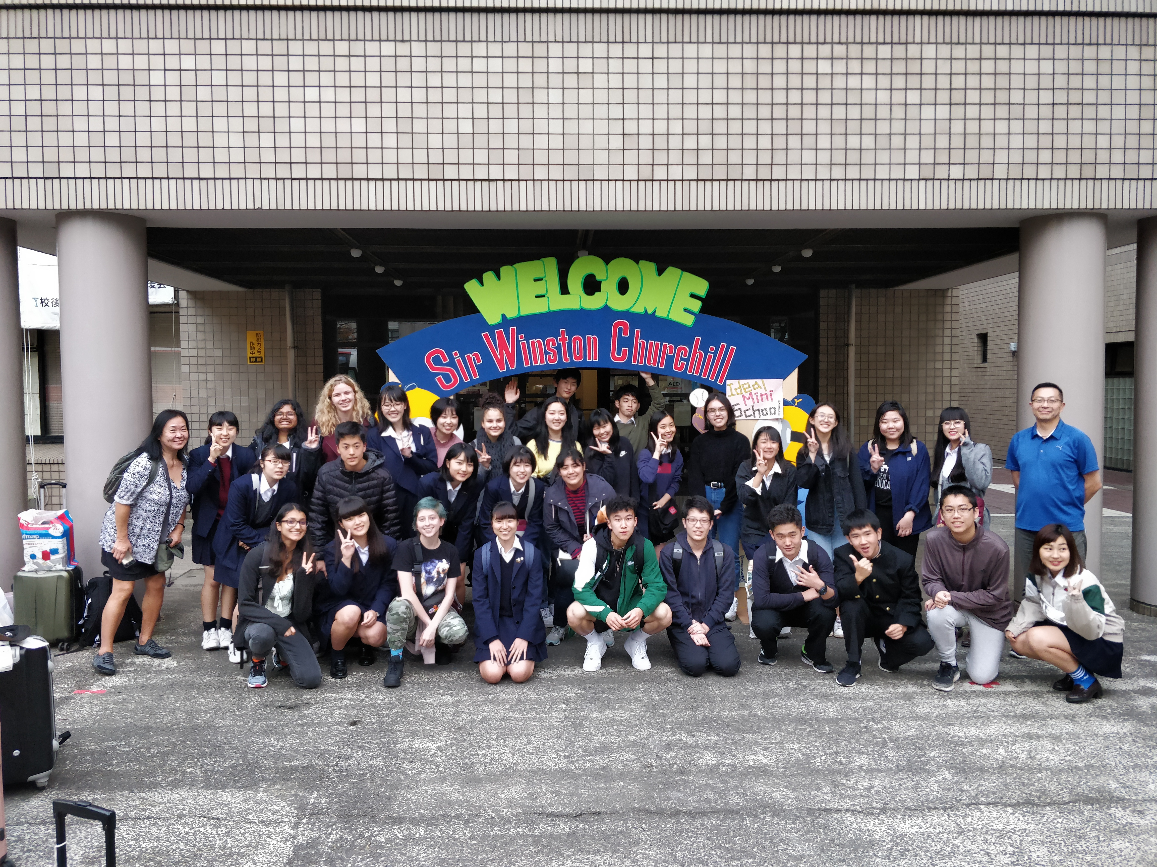 Ideal Mini excahnge students in front of Y-Ko school, Japan